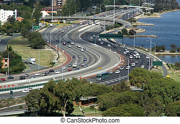 Highway - Busy highway runs alongside a river