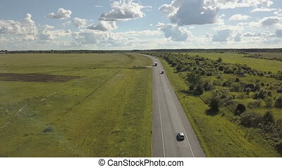 Highway road traffic in a valley . Aerial shoot of a highway...