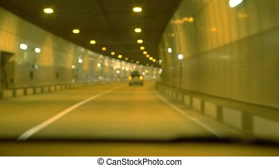 highway road tunnel, view from the window of a moving car....