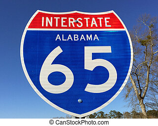 Highway sign for I-65 in Alabama. Interstate I-65 runs from north to south throughout the state of Alabama connecting most major cities.