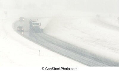 Highway snowplow 02 - Snowplow on highway during blizzard