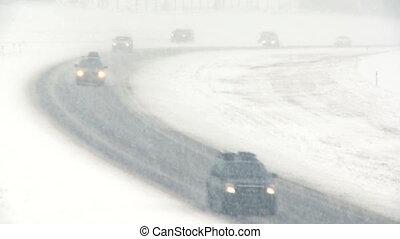 Highway snowstorm traffic 02