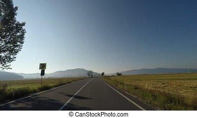Highway speeding car in a sunny day