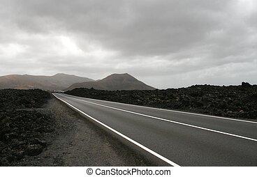 Highway in volcano landscape on Lanzarote