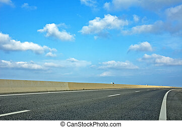 highway and blue cloudy sky