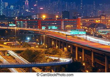 highway traffic in city at night