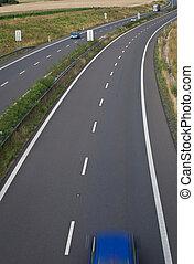 highway traffic (motion blurred image, color toned image)
