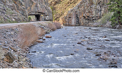 highway tunnel in the mountain river canyon