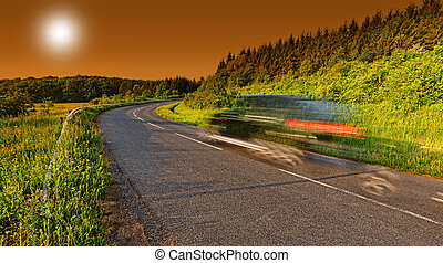 Highway with car motion blur at dusk
