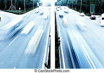 Highway with lots of cars. Blue tint, high contrast and...