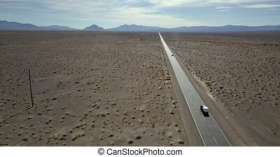 Highway with moving cars in Death Valley in USA