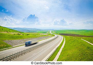 Highway with speeding truck
