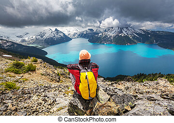 Hike in Canada - Hiking man in Canadian mountains. Hike is...