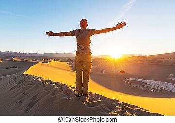 Hike in desert - Hiker in sand desert. Sunrise time.