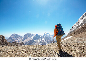 Hike in Fann mountains - Wanderlust time. Man hiking in...