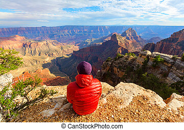 Hike in Grand Canyon - Traveler on cliff mountains over ...