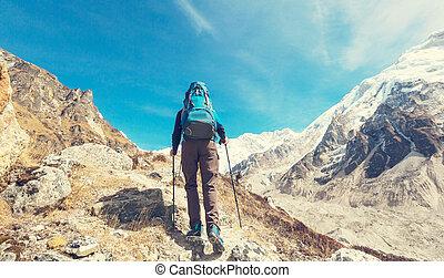 Hike in Himalayas - Hiker in Himalayas mountain. Nepal