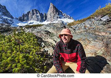 Hike in Sierra Nevada - Man with hiking equipment walking in...