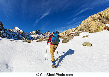 Hike in Sierra Nevada - Man with hiking equipment walking in...