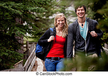 Hike Man Woman - A man and woman on a hike in the forest, ...
