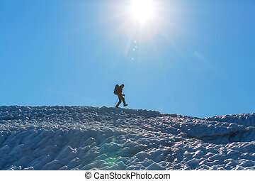 Hiker in the glacier in Alaska mountains
