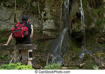 Hiker at a waterfall