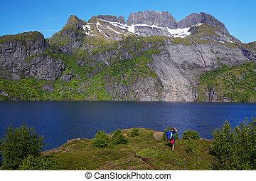 Hiker by fjord in Norway