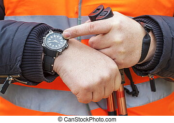 Hiker checking time on watch