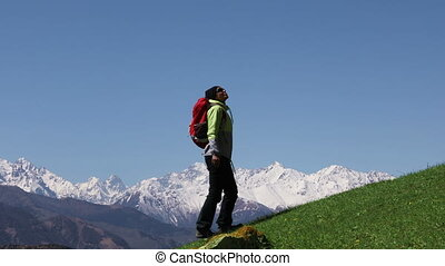 Hiker climbs the mountains - Backpacker climbs the mountains...