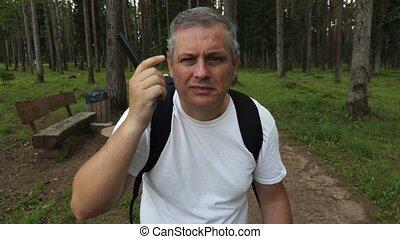 Hiker combs hair close-up