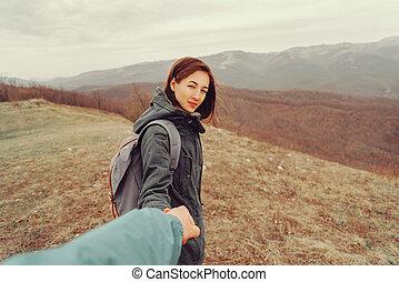 Hiker couple walking in mountains - Traveler woman holding ...