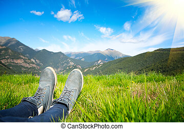 Hiker enjoying the view of nature. Meadow and mountains