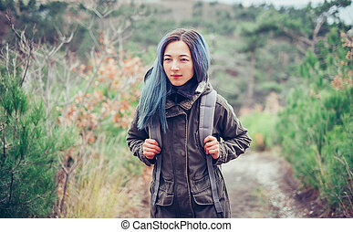 Hiker girl walking in the forest