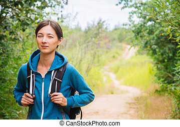 Hiker girl with backpack