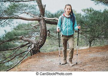 Hiker girl with trekking poles