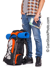 Hiker holding passport and tickets - Young tourist standing...