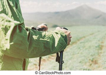 Hiker holding trekking poles