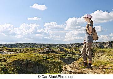 Hiker in badlands of Alberta, Canada