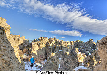 hiker in Natural Fort rock formation - a hiker in Natural ...