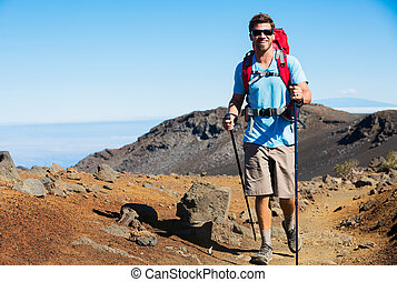 Hiker in the mountains - Hiker with backpack in the...