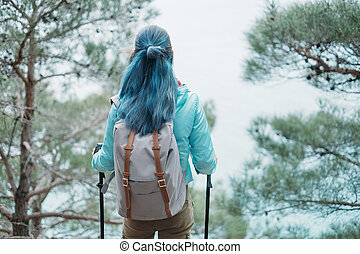 Hiker in the pine forest
