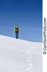 hiker in the snowy mountain