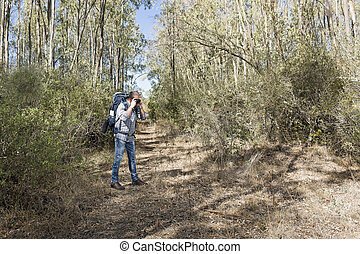 Hiker in the woods - Hiker in the Sardinian Forest with...