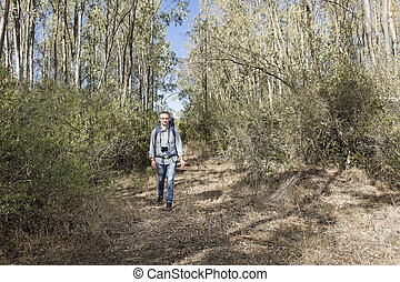 Hiker in the woods - Hiker in the Sardinian Forest of...
