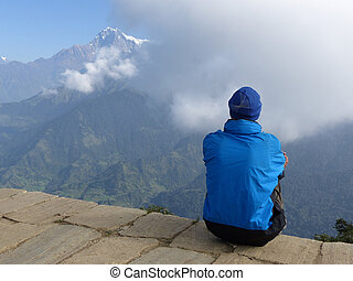 Hiker looking to the mountain on Poon Hill, Dhaulagiri range, Nepal