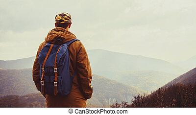 Hiker man enjoying view of mountains