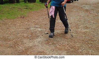 Hiker man legs walking in SLOW MOTION