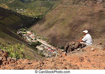 Hiker on hillside above Jamestown - Walker stopping and...