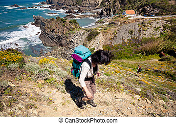 hiker on trail - hiker on hiking trail coast portugal , rota...