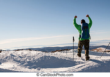 Hiker outstretching his arms on top of the mountain - Hiker ...
